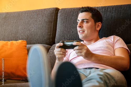 Poster Man playing with console