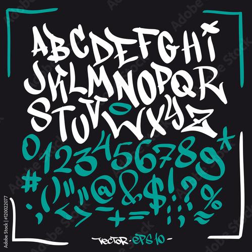 Hand written graffiti font alphabet. Vector set on black