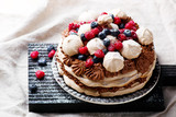 meringue cake with chocolate mousse and berries