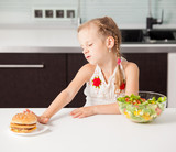 Child chooses between a healthy and unhealthy food
