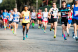 runners in marathon abstract, blurry