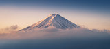 Fototapety Mount Fuji enshrouded in clouds with clear sky from lake kawaguchi, Yamanashi, Japan