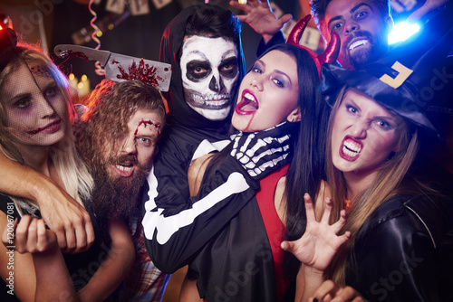 Foto Murales Spooky costumes of party people.