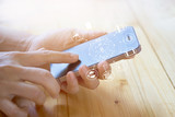 woman using mobile payments, holding circle global and icon customer