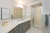 Modern bathroom with full bath shower, and tile floor, also incl