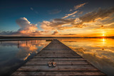 Fototapeta Landscape - Small Dock and Boat at the lake © ValentinValkov