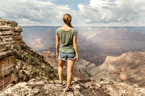 Freedom Woman standing on the edge of Mountain, Grand Canyon, south rim, Arizona, USA