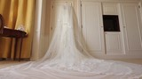 Wedding Dress Hanging Above The Bed