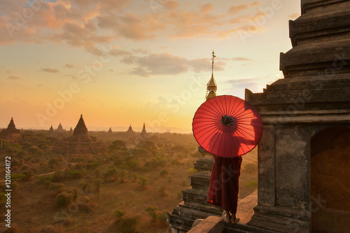 Poster Monk relaxing in ancient temple on during sunset,Bagan Myanmar