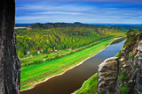 Elbe river, view from Bastei bridge in Saxon Switzerland, at sunrise and the mist over the river Elbe, National park Saxon Switzerland. Beautiful Germany landscape. Summer morning with river landscape
