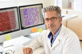 Portrait of microbiology scientist in office - 120179441