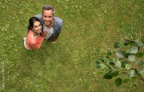 Top view. couple standing in the grass looking at the camera Poster