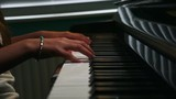 Close up of a girls hands playing piano.