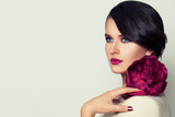 Elegant Woman Fashion Model with Burgundy Lips Makeup and Peony