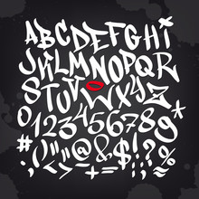 Hand written graffiti font alphabet. Vector set on black