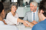 Senior businesswoman shaking hands