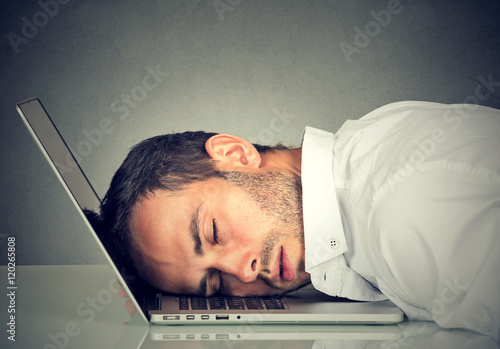 Poster Business man sleeping on his laptop in his office