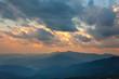Majestic Sundown Sky and Mountains Range