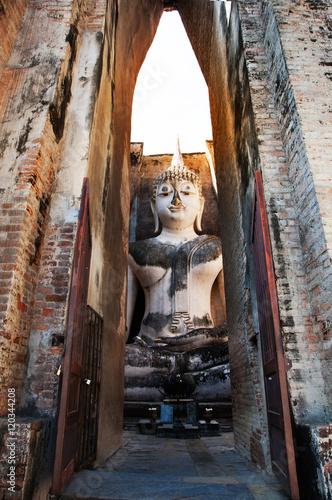 Fototapeta Ancient Big Buddha Statue at Sukhothai Historical Park, Thailand