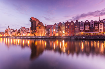 Gdansk old town with harbor and medieval crane in the evening
