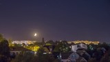 Moonset over the city timalapse