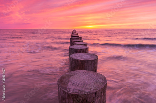 Keuken foto achterwand Crimson Wooden breakwater - Baltic seascape at sunset, Poland