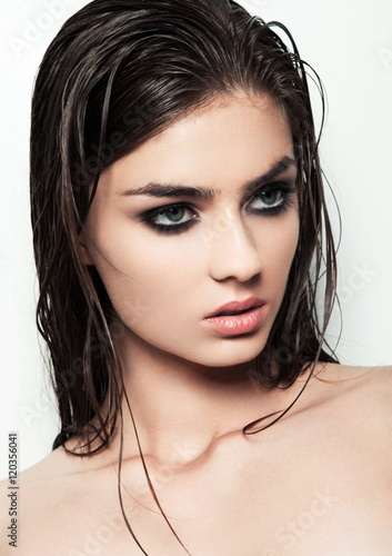 Beautiful woman with make up and wet hair on white background Plakat
