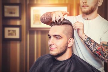 Young man having hair dress