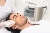 Guy having cavitation peeling at beauty salon - 120359242