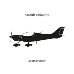 Black silhouette of a sports plane on a white background. Isolat
