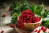 Bunches of red currant with leaves, selective focus