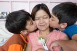 Little sibling boy give flower and kiss mom the love
