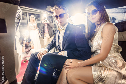 Celebrity couple in a limousine Poster