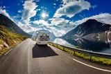 Fototapety Caravan car travels on the highway.