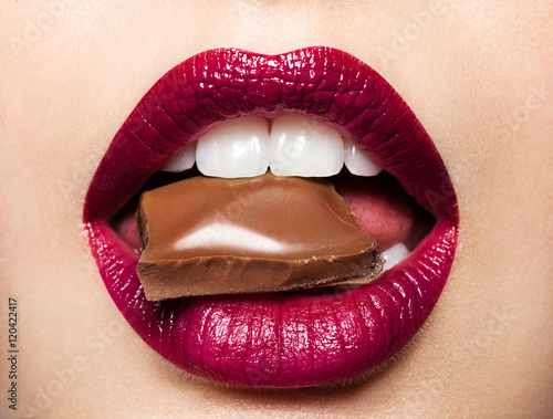 Juliste Beautiful female lips with chocolate