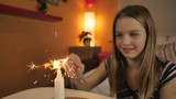 HD Slow-Mo: Girl plays with new year sparkler