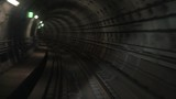 Motion along underground subway. Tunnel with lighting signs.