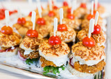 close up of canape hamburgers on serving tray