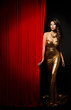 Fashion Model Girl Opening Curtain Stage, Woman Gold Dress