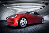 Modern red metallic sedan car in urban setting - tunnel. Generic design, brandless