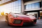 Fototapety Red fast sports car in modern urban setting. Generic, brandless design
