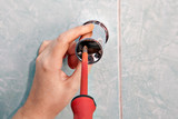 Plumbing repair, replace vertical holder shower bracket, using s