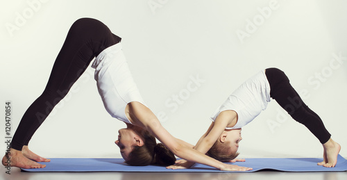 Papiers peints Ecole de Yoga mother and son doing yoga (sports exercises), have fun and spend a good time together . isolated on white. the concept of a healthy lifestyle
