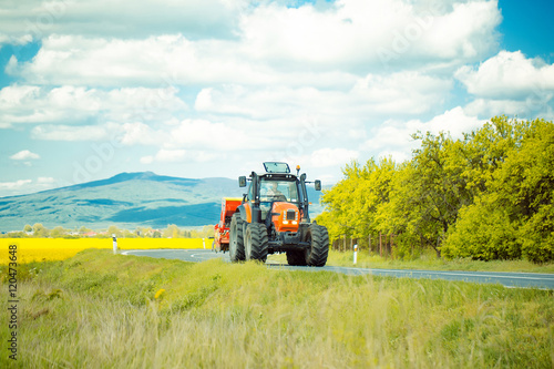 Farm tractor drives on road