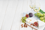 food background with wine, figs, cheeses, grape