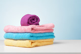 Stack of bath towels on light white background closeup - 120481667
