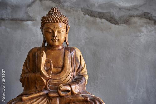 Foto op Plexiglas Boeddha Wooden buddha statue
