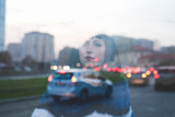 Double exposure of a young beautiful eastern woman in the city at sunset - creative, artistic concept