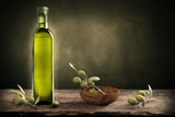 Bottle of oil with olive branch