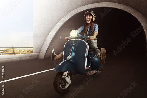Poster Asian woman with helmet riding scooter